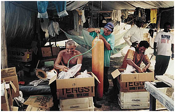 Packing boxes oxygen –  fishes are packed into polythene bags  which are filled with oxygen for the  journey to Georgetown.
